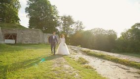 Lovely wedding couple walks near the castle. Slowly stock video