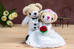 Lovely wedding dolls. Lovely wedding bear dolls on wooden floor stock image