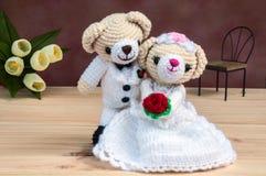 Lovely wedding dolls. Lovely wedding bear dolls on wooden floor Stock Image