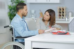 Lovely wife cooking or disabled husband. Lovely wife cooking or her disabled husband Stock Image