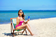 A lovely woman adding suntan on the beach Royalty Free Stock Photo