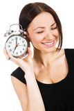 Lovely woman with alarm clock Royalty Free Stock Photography