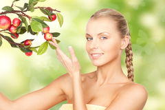 Lovely woman with apple twig and butterflies Royalty Free Stock Images