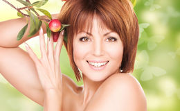 Lovely woman with apple twig and butterflies Stock Photos
