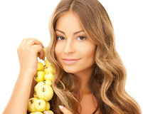 Lovely woman with apple twig Royalty Free Stock Photography