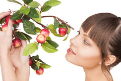 Lovely woman with apple twig Royalty Free Stock Photos