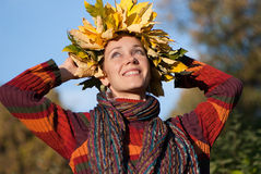 Lovely woman with autumn wreath on her head Stock Images