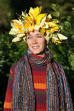 Lovely woman with autumn wreath on her head Royalty Free Stock Photos