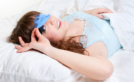 Lovely woman in the bed Stock Images