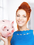 Lovely woman with big piggy bank. Picture of lovely woman with big piggy bank Royalty Free Stock Photography