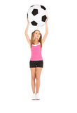 Lovely woman with big soccer ball Stock Image
