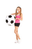 Lovely woman with big soccer ball Stock Photo