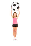 Lovely woman with big soccer ball Royalty Free Stock Photography