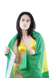 Lovely woman with bikini and Brazilian flag Royalty Free Stock Images