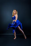 Lovely woman in blau costume dancing belly dance Stock Images