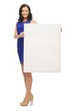 Lovely woman in blue dress with blank board Stock Image