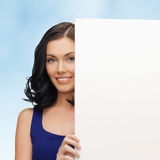 Lovely woman in blue dress with blank board Royalty Free Stock Photo