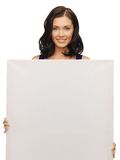 Lovely woman in blue dress with blank board Stock Photos