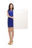 Lovely woman in blue dress with blank board Royalty Free Stock Image