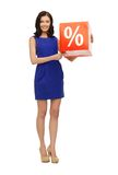Lovely woman in blue dress with percent sign Stock Image