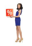 Lovely woman in blue dress with percent sign Stock Images