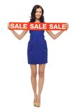 Lovely woman in blue dress with sale sign Royalty Free Stock Photos