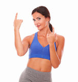 Lovely woman in blue pointing up Stock Photography