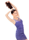 Lovely woman in blue sun-dress playing with hairs Royalty Free Stock Image