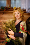 Lovely woman with a bouquet of dried daisies Royalty Free Stock Photography