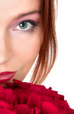 Lovely woman with a bouquet of red roses Royalty Free Stock Photo