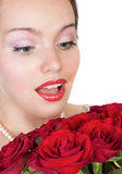 Lovely woman with a bouquet of red roses Stock Image
