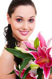 Lovely woman with bunch of flowers royalty free stock photography