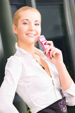 Lovely woman with cell phone Royalty Free Stock Photography