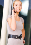 Lovely woman with cell phone Stock Images