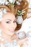 Lovely woman with christmas balls Royalty Free Stock Photos