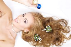 Lovely woman with christmas decorations Royalty Free Stock Images