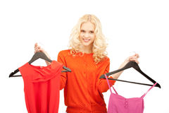 Lovely woman with clothes Stock Image