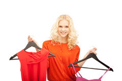 Lovely woman with clothes Stock Photos