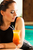 Lovely woman with cocktail glass in water Stock Image