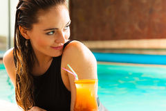 Lovely woman with cocktail glass in water Stock Photography