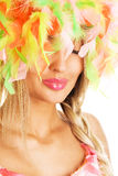 Lovely woman in colorful funny hat Royalty Free Stock Photography