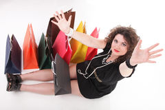 Lovely woman with colorful shopping bags or gifts Stock Photography
