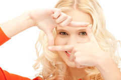Lovely woman creating a frame with fingers Stock Images