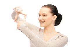 Lovely woman creating a frame with fingers Royalty Free Stock Image