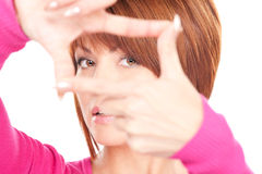 Lovely woman creating a frame with fingers Stock Image