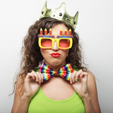Lovely woman with crown and funny sunglasses Stock Photo