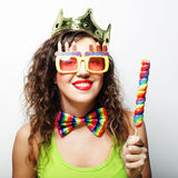 Lovely woman with crown and funny sunglasses Royalty Free Stock Image