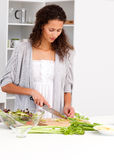 Lovely woman cutting vegetables in the kitchen Stock Images