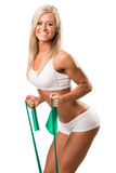 Lovely woman doing fitness exercises with rubber band Royalty Free Stock Images