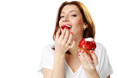 Lovely woman eating fresh strawberry cake Royalty Free Stock Image